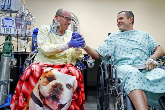 Michael Kaltenmark, left, tells brother Doug Kaltenmark that he loves him on Friday at University Hospital. Doug donated the kidney for the transplant surgery on Thursday.