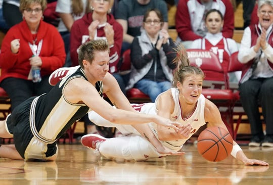 Indiana Hoosiers guard Ali Patberg (14) and Purdue Boilermakers forward Rickie Woltman (35) dive for a looseball during the Indiana-Purdue game at Simon Skjodt Assembly Hall in Bloomington, Ind., on Thursday, Jan. 9, 2020.