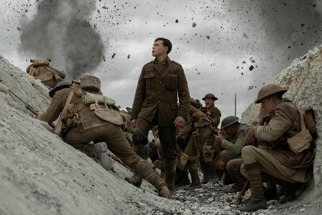"George MacKay as Lance Corporal Schofield looks over the edge of a World War I trench in the Golden Globe-winning film ""1917."""