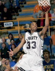 Liberty's Jewuan Long (33) led the Crusaders to the Class AA state championship in 2006 and '07.