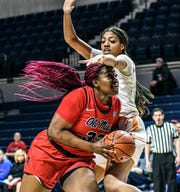 Mississippi forward Iyanla Kitchens (32) is defended by Tennessee center Tamari Key (20) during an NCAA college basketball game in Oxford, Miss., Thursday, Jan. 9, 2020. (Bruce Newman/The Oxford Eagle via AP)