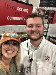Kim Frazier talks last month with Tanner Robinson, general manager at Elder's Ace Hardware, about hosting a community day with live music. 12/7/19