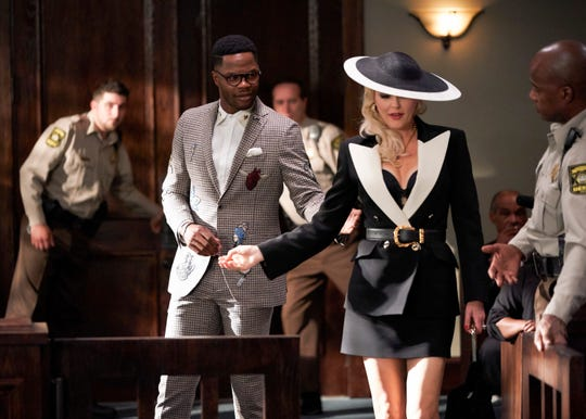 "Sam Adegoke stars as Jeff Colby, and Elaine Hendrix stars at  Alexis Carrington in The CW's ""Dynasty."""