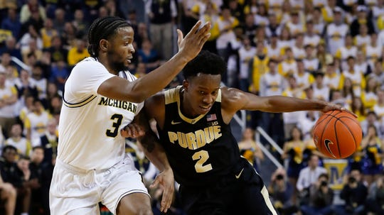 Purdue guard Eric Hunter Jr. (2) drives on Michigan guard Zavier Simpson (3) during the first half of an NCAA college basketball game in Ann Arbor, Mich., Thursday, Jan. 9, 2020. (AP Photo/Paul Sancya)