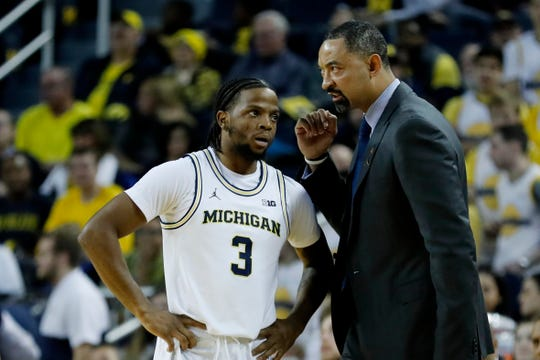 Jan 9, 2020; Ann Arbor, Michigan, USA; Michigan Wolverines head coach Juwan Howard (right) talks to guard Zavier Simpson (3) in the first half against the Purdue Boilermakers at Crisler Center. Mandatory Credit: Rick Osentoski-USA TODAY Sports