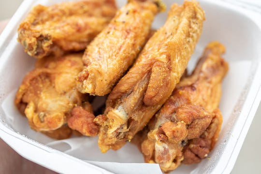 Who Dat Wings in New Orleans makes both naked wings, like this lemon pepper order, and sauced wings.