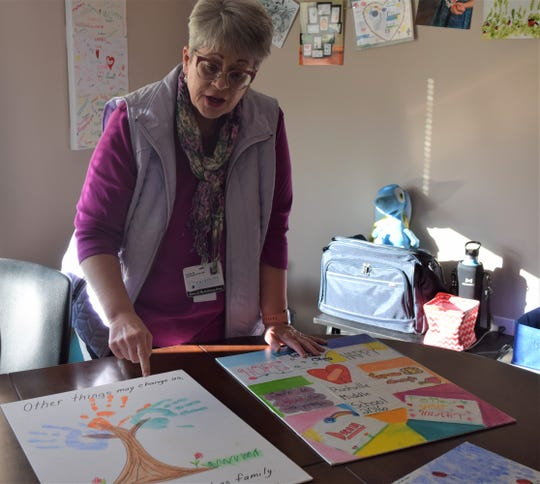 Tracey Miller describes the significance in the drawings made by some of the students she's counseled. Miller is the grief support manager at FAIRHOPE Hospice and Palliative Care, and she helps children and adults find ways to process their grief for loved ones they've lost.