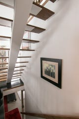 Floating stairs provide views from one space to another in the Peters home, shown Thursday, Jan. 9, 2020.