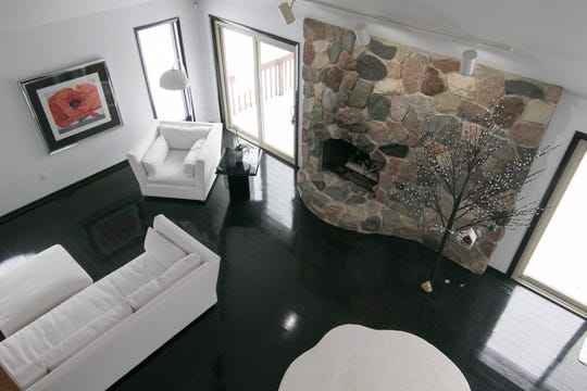 A view from the second floor office area overlooks the bright living room of the Peters home, shown Thursday, Jan. 9, 2020.