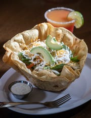 The Taco Salad comes in a crispy tortilla bowl with your choice of meat, lettuce, tomatoes, carrots, cucumber, bell pepper, onions, spinach, shredded cheese with sour cream and avocado. It's a meal for $9.99. Jan. 8, 2020