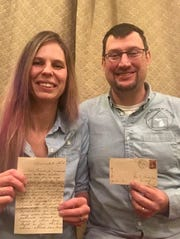 Rachel and Ivan Morris, who own Home Buyers of Michigan, show the 1800s letter and envelope they found that has intrigued readers on Facebook.