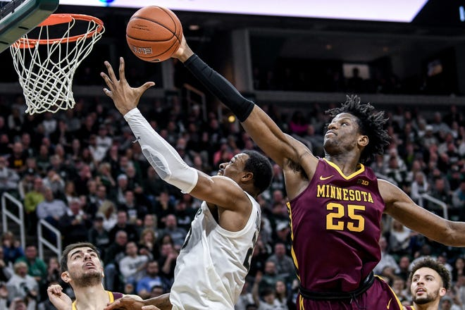 Minnesota's Daniel Oturu, right, a Big Ten player of the year candidate, grabs a rebound over Michigan State's Xavier Tillman during their Jan. 9 meeting at Breslin Center.