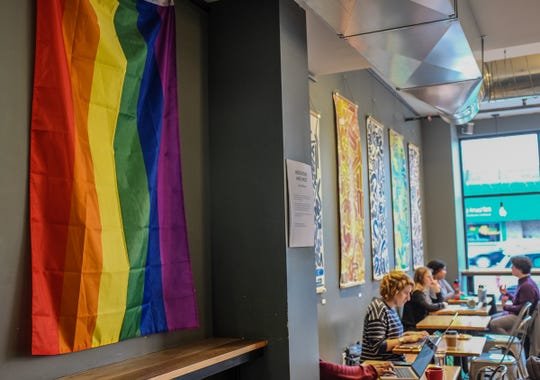 Strange Matter Coffee on Michigan Avenue in Lansing prominently displays a LGBTQ rainbow flag Friday, Jan. 10, 2020.