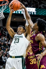 Michigan State's Xavier Tillman, left, pulls down a rebound over Minnesota's Marcus Carr during the first half on Thursday, Jan. 9, 2020, at the Breslin Center in East Lansing.