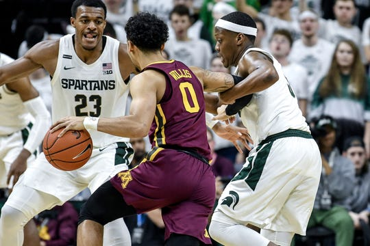 Michigan State's Cassius Winston, right, and Xavier Tillman pressure Minnesota's Payton Willis during the second half on Thursday, Jan. 9, 2020, at the Breslin Center in East Lansing.