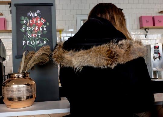 Signage at Strange Matter Coffee on Michigan Avenue in Lansing.