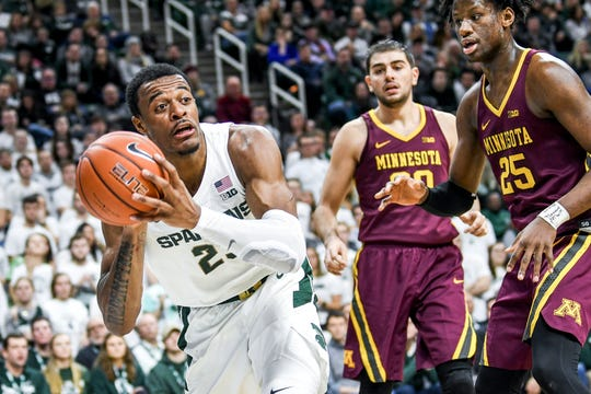 Michigan State's Xavier Tillman passes the ball during the first half on Thursday, Jan. 9, 2020, at the Breslin Center in East Lansing.