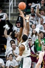 Michigan State's Xavier Tillman, right, blocks a shot by Minnesota's Daniel Oturu during the second half on Thursday, Jan. 9, 2020, at the Breslin Center in East Lansing.