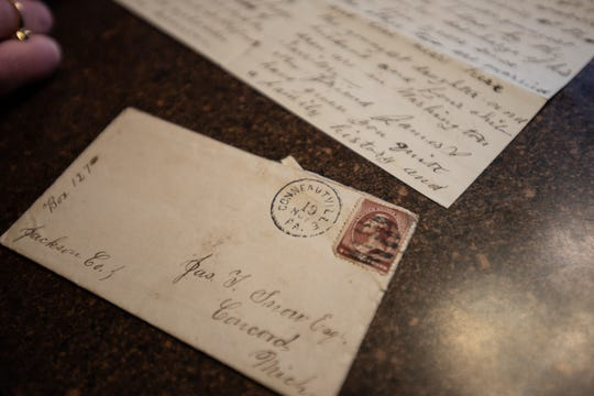 Rachel Morris of Eaton Rapids shows a letter Friday, Jan. 10, 2020, she and her husband found in a home they are renovating in northwest Lansing.