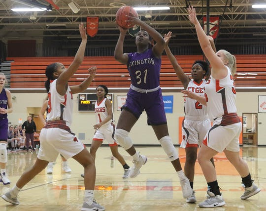 Lexington's Avery Coleman posted a 12-point, 12-rebound double-double in a 39-26 win over Mansfield Senior on Thursday night.