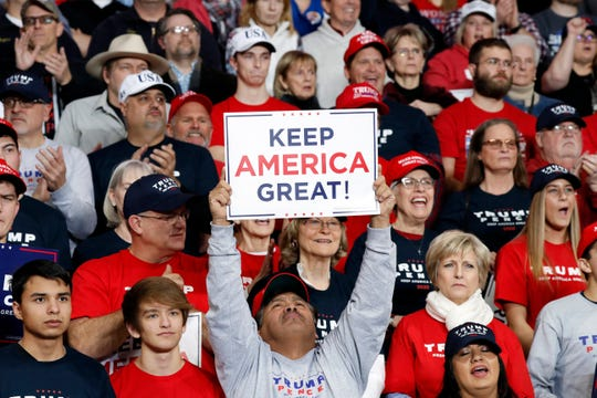Supporters listen as President Donald Trump speaks at a campaign rally Thursday in Toledo. (AP Photo/ Jacquelyn Martin)