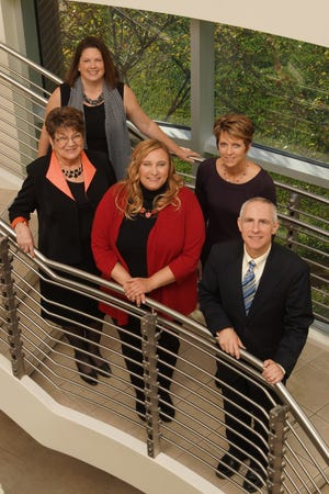 The staff of Marion Community Foundation includes, front, from left,Lori Stevenson, Diana Rinesmith andDean Jacob; and back,Diane Mault and Julie Prettyman. Not pictured:Tera Holderman.