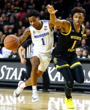 Memphis Tigers guard Tyler Harris is called for a charge while bringing the ball up court against Wichita State Shockers guard Tyson Etienne during their game at the Charles Koch Arena in on Thursday, Jan. 9, 2020.
