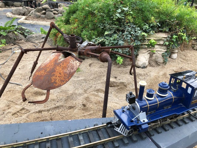 The trains at the Domes' annual train and garden show will drive by sculptures of giant monsters, such as this spider.