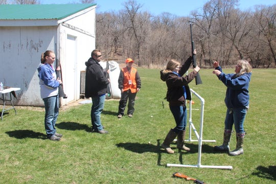 Students practice safe firearm handling in a fence crossing exercise at a 2018 hunter education field day offered at the Wisconsin Hunter Education Instructor Association conference in Fond du Lac.