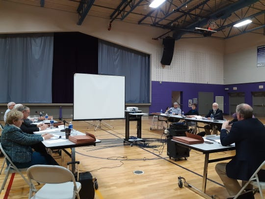 Members of the School District Boundary Appeal Board discuss the proposed dissolution of the Palmyra-Eagle Area School District at a meeting Thursday, Jan. 9, 2020, at the Palmyra-Eagle Middle School gymnasium. The board voted 6-1 to deny dissolution and keep the school district open.