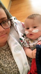 Robin Komassa, one of Colton Komassa's moms, holds him at Children's Hospital of Wisconsin, where he was being treated for respiratory syncytial virus.