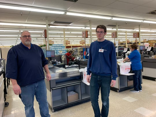 "Tom Gast, the Fox Run Sentry store's manager, stands with his son Matt, also an employee, on Jan. 9 near the checkout lanes. Gast said literally and metaphorically, customers and employees have been ""family"" over the years."