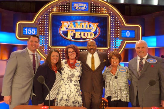 "A Germantown family, the Olszewskis, were contestants on ""Family Feud"" on Oct. 3, Oct. 14 and 15, 2019. The won $20,000. Pictured are Jay Olszewski, from left, Nicki Olszewski, Jodie Gariety, ""Family Feud"" host Steve Harvey, Kathy Olszewski and Joe Olszewski."