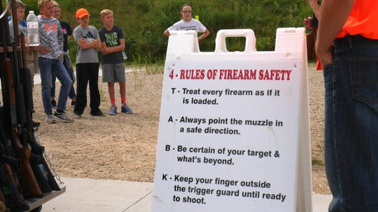 The four cardinal rules of firearm safety are listed on a sign at an outdoor session of a Wisconsin hunter education class. Mandatory safety education has helped lead to a marked reduction in firearm-related injuries and deaths during Wisconsin hunting seasons.