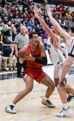 Sussex Hamilton's Patrick Baldwin Jr. (23) looks for a path around Brookfield East's Nick Pluemer (24) on Thursday, Jan. 9, 2020.