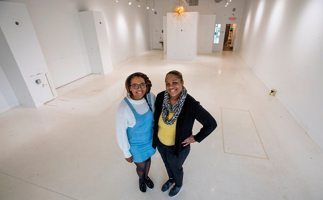 Mother-daughter business owners Imani Whitehead, left, and Monica Virgil, right, pose in the space that will become their Wine & Design franchise in EastChase in Montgomery, Ala., on Friday January 10, 2020.