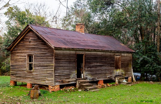 An old slave cabin is seen at the Elms, an antebellum plantation house in Coosada, Ala., that is used as a wedding and event venue, on Thursday January 9, 2020.
