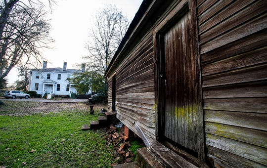 An old slave cabin is seen beside the Elms, an antebellum plantation house in Coosada, Ala., that is used as a wedding and event venue, on Thursday January 9, 2020.