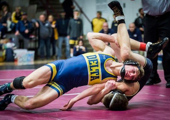 Delta's Payne Blackburn competes against Daleville during the county wrestling tournament at Wes-Del High School Thursday, Jan. 9, 2020.