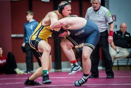Cowan's Tom Stevens (left) wrestles during the Delaware County wrestling tournament at Wes-Del High School Thursday, Jan. 9, 2020.