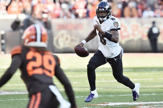 Dec 22, 2019; Cleveland, Ohio, USA; Baltimore Ravens quarterback Lamar Jackson (8) runs the ball as Cleveland Browns defensive back Sheldrick Redwine (29) defends during the second half at FirstEnergy Stadium.