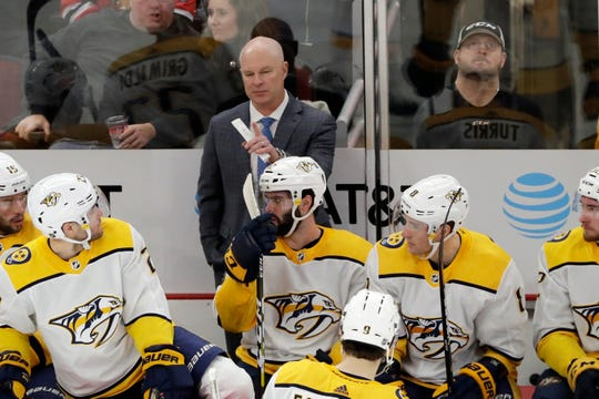 Nashville Predators head coach John Hynes, top, talks to his team during the first period against the Chicago Blackhawks in Chicago, Thursday, Jan. 9, 2020.