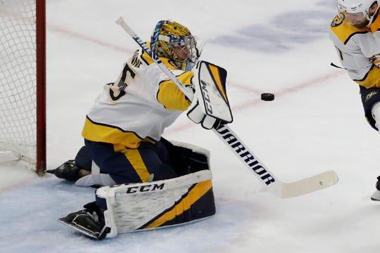 Nashville Predators goalie Pekka Rinne blocks a shot by the Chicago Blackhawks during the first period in Chicago, Thursday, Jan. 9, 2020.