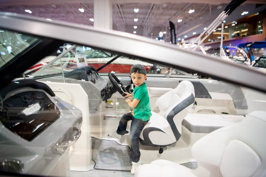 Cameron Ramsey, 3, takes his turn behind the wheel during the Nashville Boat Show at Music City Center Friday, Jan. 10, 2020, in Nashville, Tenn.