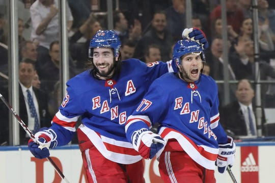 Tony DeAngelo #77 of the New York Rangers (R) celebrates his hattrick goal on the power-play at 15:02 of the 2 against the New Jersey Devils and is joined by Mika Zibanejad #93 (L) at Madison Square Garden on Jan. 9, 2020 in New York City.