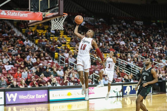 Redshirt sophomore Jabari Rice throws down a dunk during New Mexico State's home game against the Chicago State Cougars on Jan. 9 at the Pan American Center.