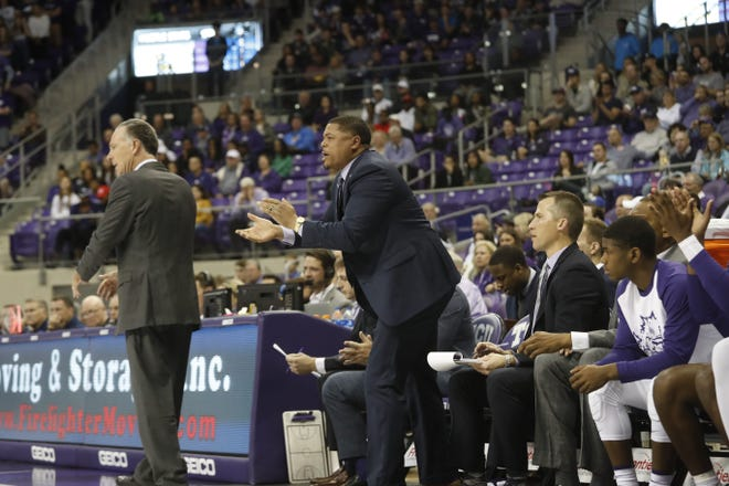 Corey Barker (left) coaches from the sidelines during his time at TCU.