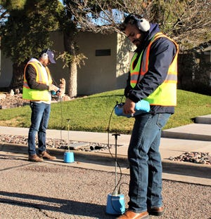 LCU Leak Detection Technicians Elexis Davalos and Luis Gonzalez listen for the sound of water possibly leaking out of water pipes under the street. Using ground microphones, they can identify leaks before they grow, cause damage and waste water.