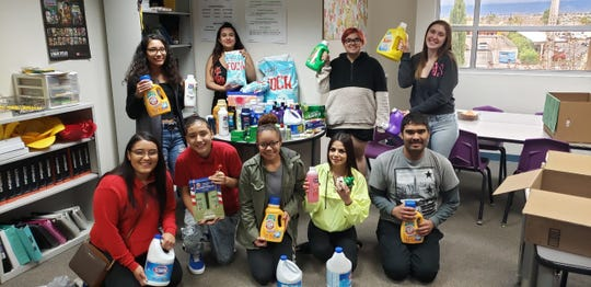 Students at the New America School-Las Cruces display some of the items they collected as part of the school's annual hygiene drive.