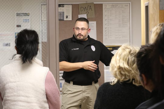 Carlsbad Police Cpl. Joshua Calder speaks to attendees at a women's self-defense class, Jan 9, 2020 at the Carlsbad Police Department.
